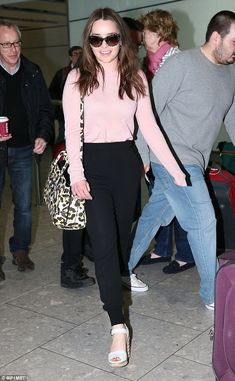 Down to earth: The GOT star, seen arriving at London's Heathrow Airport on March 27, tells Harper's Bazaar that her family and friends still aren't used to her fame