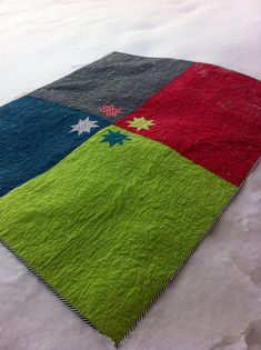 Got a few quilt blocks left over?  Throw them in the center of the back, with contrasting colors.  Great Idea.
