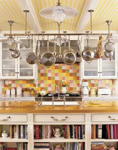 Kitchen with fun colorful tiles and hanging pot rack.