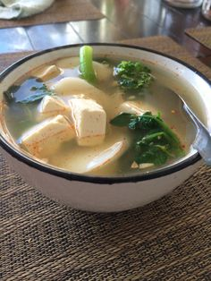 Tofu, Watercress leaf, Asian mustard greens, Korean rice cake, hot chili oil, in a hot chicken broth and squeezes of lime.
