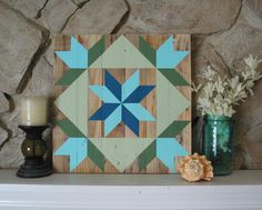 This rustic barn quilt hand crafted from reclaimed pallet boards would look great in any room of your house. While the traditional barn quilt