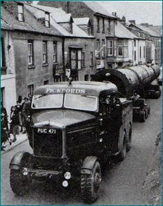 Dew Street, Haverfordwest circa 1958. The beginning of construction of the Esso Oil Refinery at Milford Haven, some 6 miles away. Everything had to negotiate the steep and narrow roads of Haverfordwest!