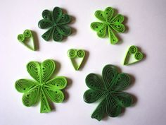 QUILLING - St. Patrick's Day CLOVERS or SHAMROCKS w/ green hearts, by Adria Carr via Etsy.