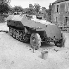 BRITISH ARMY NORMANDY 1944 (B 5609)   A captured German SdKfz 251 ambulance half-track, 15 June 1944.