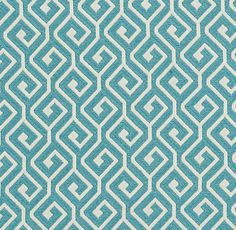 Kyra Key Fabric A woven fabric with an interlocking geometric design in turquoise and ivory.