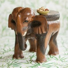This Surin Elephant Ride Table is hand carved from solid Monkey Pod wood. Each piece has smooth curves, intricate carving and a practical surface. Charmed Characters, Monkey Pod Wood, Elephant Ride, Hand Wax, Hand Carved, Curves, Artisan, Surface, Smooth