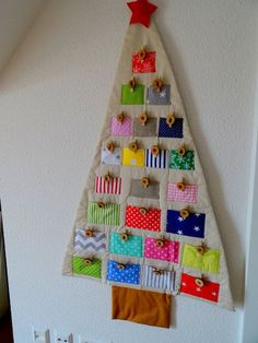 Advent Calendar of fabric (cotton) in colourful Adventskalender The post Advent Calendar of fabric (cotton) in colourful appeared first on Adventskalender ideen. Diy Felt Christmas Tree, Christmas Trees For Kids, Fabric Christmas Trees, Christmas Sewing, Christmas Crafts, Advent Calenders, Diy Advent Calendar, Xmas Tree Decorations, Ornaments Ideas