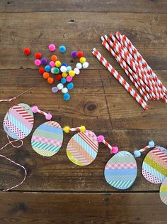 make egg garland with washi tape, straws and pompoms