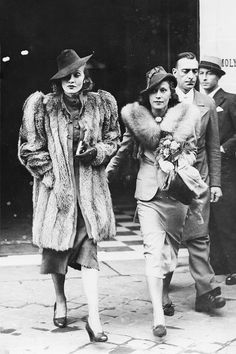 Marlene Dietrich with her husband's mistress, Tamara Matul, exiting from the fashion house of Edward Molyneux in Paris, September 1937