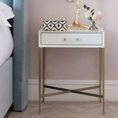 A stunning side table in white, with polished brass legs and finishes. If you're looking for a new side table to help brighten up the rooms in your home, this is it! There is a generously sized drawer at the front of the table, for all the little bits and Side Table Decor, Brass Side Table, White Side Tables, Bedroom Furniture Design, Large Furniture, Living Room Furniture, Modern Bedside Table, Bedside Tables, Nightstand