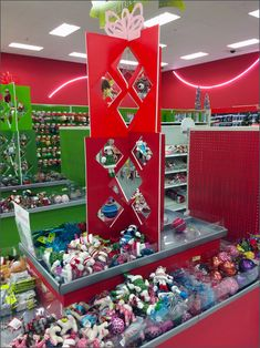 One of the most festive Holiday Departments I have encountered, the centerpiece is this Cut-Out Foamcore tower for display of Christmas Ornaments. It allows merchandise to be hung almost Christmas-...