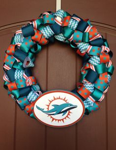 Miami Dolphins ribbon wreath with hand painted team logo.