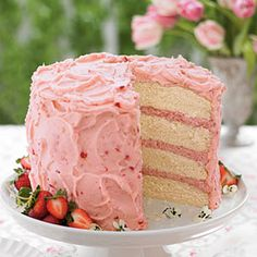 Strawberry Mousse Cake ~ Strawberry-sweetened frosting surrounds the outside of the cake while creamy strawberry mousse divides the layers.