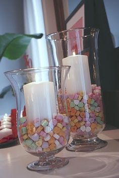 This one is super easy: place a white pillar candle inside a hurricane vase and fill with candy hearts. Be sure to look for the eight new messages for 2015, including Girl Power and BFF. #ValentinesDay #Love #DIY #Project
