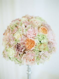 Blush pink, peach & cream hydrangea and roses flower ball floral arrangement - Image by Peachey Photography - A Lambina dress by Pronovias for a Spring wedding at Northbrook park in Surrey with a pink rose bouquet by Peachey Photography.