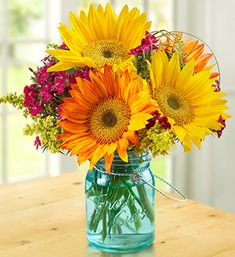 Love this arrangement in a Blue Mason jar! Looks so cheerful. Came across it on Flowers.com.
