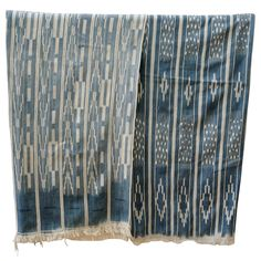Africa   Indigo resist textiles from the Ivory Coast   Narrow hand woven strips sewn together.  Natural indigo