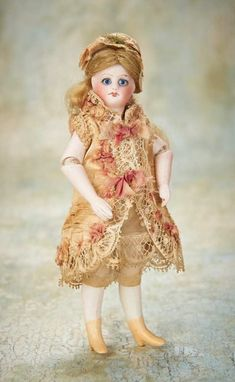 Small Courtesies: 36 Rare French All-Bisque Mignonette with Jointed Elbows and original Costume