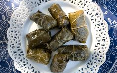 A traditional Greek appetizer recipe of rice-and-beef-stuffed grape leaves served with a tangy lemon sauce.