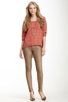 Faux leather jeans. Detailed brick colored top. Long gold chain necklace. 3/2 for sure.