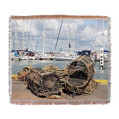 Lobster pots, Yarmouth, England Woven Blanket on CafePress.com