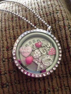 Origami Owl Living Locket... To place your order, visit my website at http://yourcharminglocket.origamiowl.com/ Have further questions, message me on Facebook https://www.facebook.com/YourCharmingLocket. --LIKE OUR FAN PAGE FOR A CHANCE TO WIN A FREE CHARM. 3 WINNERS EVERY MONTH--- Want more than just one locket, consider joining our team for an extra income.