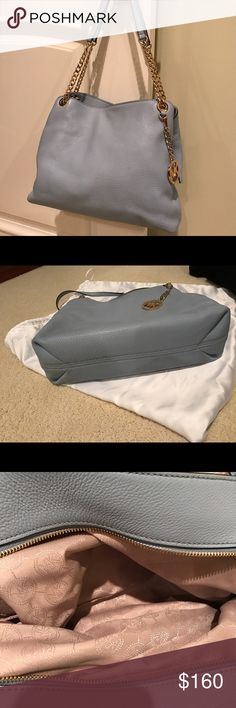 💥MICHAEL KORS JET SET💥⭐️⭐️⭐️⭐️. ❤⭐️💫Rare pale blue❣⭐️👜❣Gently  and carefully used baby blue , pebble leather bag. 3 compartment, one with zipper, other is a snap. Inside beautiful, without stains. Condition extremely good. Inside wallet clip. With dust bag.✨💫👜⭐️⭐️⭐️⭐️⭐️.  9.5 tall by 13 wide by 4.5 deep. MICHAEL Michael Kors Bags Satchels