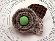 crochet brooch- I love the mix of material with crochet, and the button! Crochet Accessories, Hair Accessories, Tweed, Crochet Brooch, Create And Craft, Knitted Throws, Spring Sale, Crochet Flowers, Baby Knitting