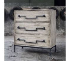 Antique Accent Chest Three Drawer Iron Swing Bar Drawer Pulls  UTTERMOST AGED IVORY ACCENT CHEST 3 DRAWERS AGED IRON DROP SWING DRAWER PULLS  The Uttermost Jory Accent Chest is constructed from plantation grown mango wood in an aged ivory finish with ember highlights. This rustic chest features old iron drop swing bar drawer pulls on an industrial base making it a stylish addition to any room.
