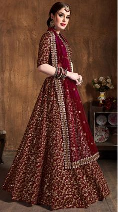 This Maroon Raw Silk Lehenga Choli has embroidery patch work. Zari And Sequins Heavy Embroidery Work can be customized up to size 42 only. Soft net dupatta comes with lehenga choli. Lehenga Choli Latest, Long Choli Lehenga, Sabyasachi Lehenga Bridal, Indian Wedding Lehenga, Raw Silk Lehenga, Bridal Lehenga Online, Designer Bridal Lehenga, Lehenga Choli Online, Latest Bridal Lehenga Designs
