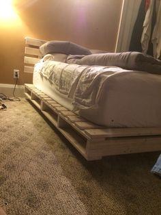 Floating pallet bed frame