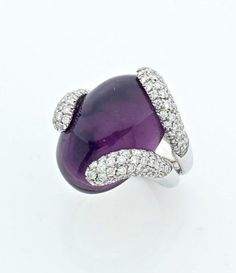 AN AMETHYST, DIAMOND AND WHITE GOLD RING