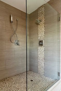 Pebble accents and beige faux wood tile. Tile on floor rather than pebble.