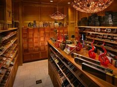 """Rocky Patel """"recently"""" opened his high-end flagship cigar lounge in Naples, Florida. Not sure why Naples, I would have picked Miami. Cigar Humidor, Cigar Bar, Cigar Store, Premium Cigars, Cigar Room, Cigars And Whiskey, Lounge Design, Basement Renovations, House Music"""