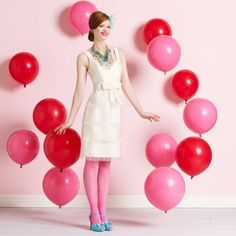 "(""balloons pinned to the floor would be a cute background for a photo booth."")  This is actually a clever idea."