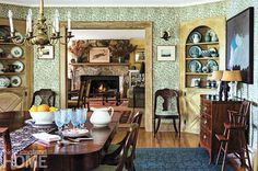 1920s Cottage Dining Room Natural wood trim, birch floors, a muted palette, and William Morris–inspired wallpapers create a backdrop for period furnishings, many of them family heirlooms.1 of 15Next »« PrevClose