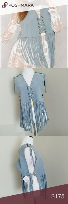 """Vintage estee suede fringe top Authentic vintage piece  100"""" real amazing quality suede. The ad shoulders, front and sides. Aprox 18"""" width lying flat. Made to be oversized. V cut in front and back. Purchased inline from Nasty Gal so authenticity is 100% apox. 10"""" of hanging suede Vintage Tops"""