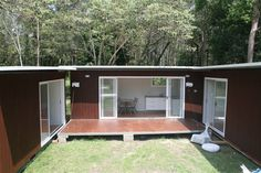 Shipping container homes with private courtyard... MY THOUGHTS>>> Put containers in a square. Add the self sustaining garden pool cover home in gillie suit type material. Fortify the exterior, add cistern,