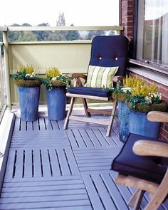 Balcony with blue flooring, comfortable chairs, and flowers