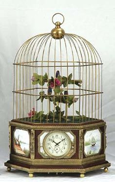 Antiqued gilded finish bird cage with three birds, an antique clock face & pastoral landscapes encompasses the cabinetry! Antique Bird Cages, Antique Clocks, Victorian Trading Company, Unusual Clocks, Victorian Art, Beautiful Kitchens, Bird Feathers, Art Decor, Home Decor