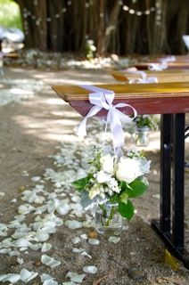 Ceremony under the big fig tree - simple bench with flowers!