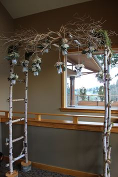 wedding arbor birch wood, vintage  rustic, manzanita branches, lace jars, hanging flowers, babies breath, peach, coral, blush pink, moss  http://sophisticatedfloral.com/users/awp.php?ln=110659