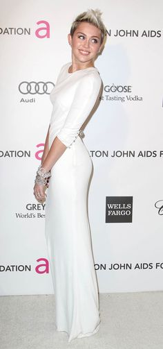 Nice Hot Hollywood Celebrity Miley Cyrus Dress Is On Backwards .   7 Hi-Resolution images in gallery.