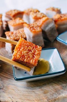 Cantonese Roast Pork Belly, or siu yuk can be found hanging in many Chinatown restaurant windows but you can make this crispy roast pork belly recipe at home!