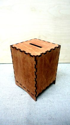 This listing is for wooden Saving bank.  - Dimensions: 8cm X 8cm X 11.5cm ( 3.1 Inch X 3.1 Inch X 4.5) Hole diameter 35mm (1.3Inch) - Material: wood - painted walnut color - a removable cap that stays with magnets