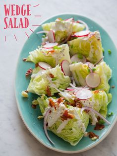 Wedge Salad with Iceberg Lettuce. I might try this with green cabbage, ranch dressing, and pickled onions along with the other toppings.