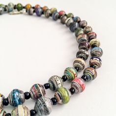 $65 on Etsy!! GORGEOUS!! Long beaded necklace with colorful rounded pearl-like paper beads made with recycled paper from magazines. Each necklace is composed of around 60