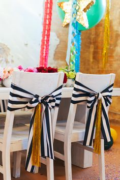 Stripes and tinsel chair bows // event design by Couture Events, photo by Matt & Julie Weddings