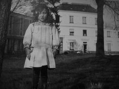 Louise Bourgeois in front of her home at Choisy-le-Roi, where her parents repaired old tapestries.