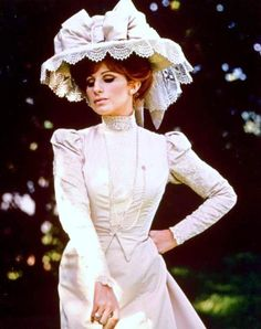 1969 / Barbra Streisand as Dolly Levi on her wedding day in the musical, HELLO DOLLY! She looked really pretty in this Edwardian ivory colored gown with the ginormous hat, trimmed with a ginormous bow.